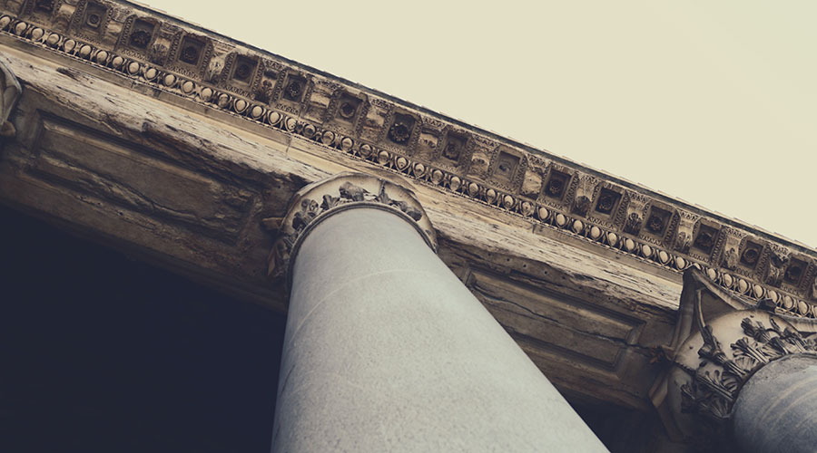 Photograph of two Greek columns supporting a building.